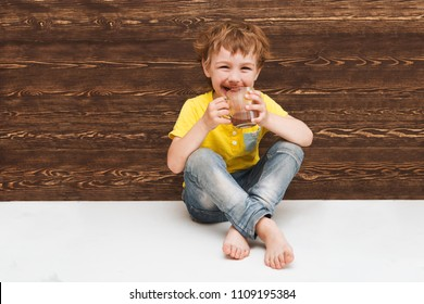 the kid drinking cocoa at home.