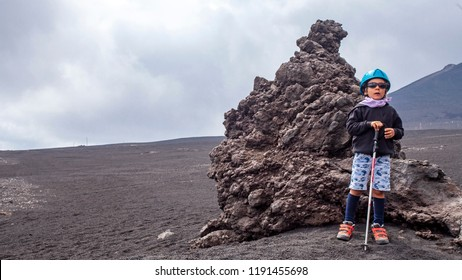 Kid during an excursion on the Etna, Sicily, Italy