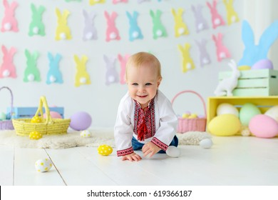 Kid in easter decorations, beautiful baby in embroidered