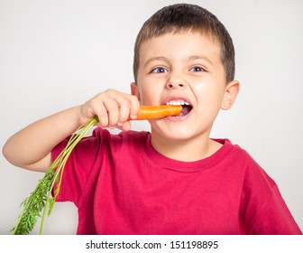 Kid eating delicious carrot