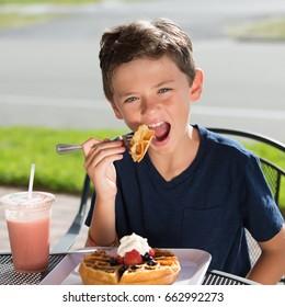 Kid Eating Waffle