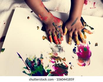 kid enjoying his painting