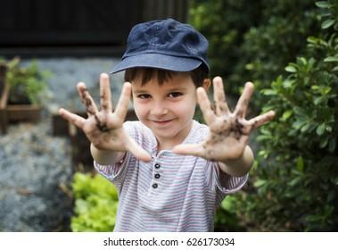 Kid is in a garden