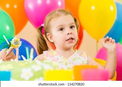 kid girl eating cake on party birthday