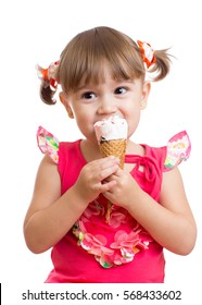 Kid girl eating with ice cream in studio isolated on white