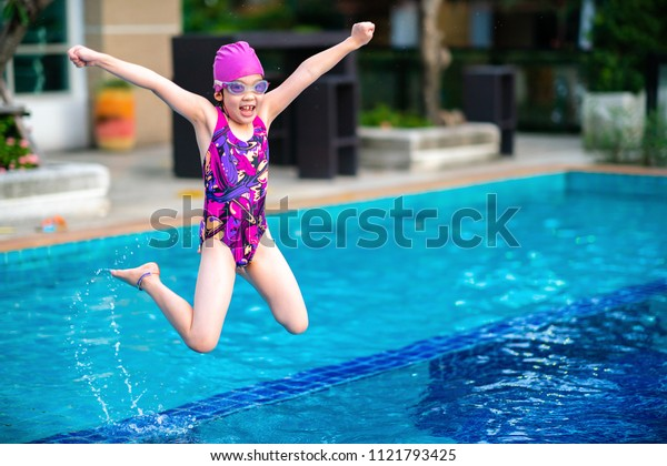 Kid, Girl, Jumping into Swimming Pool with Fun and Happiness