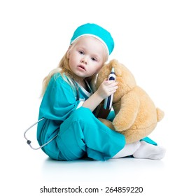 kid girl playing doctor with plush toy isolated on white