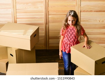 Kid girl relocating boxes background. Relocating concept. Delivery service. Box package and storage. Small child prepare for relocation. Relocating family can be exciting, but also stressful for kids.