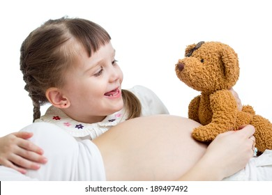 kid girl telling a tale to baby in pregnant mother's belly