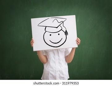 kid graduate with drawing  graduation cap,  School concept