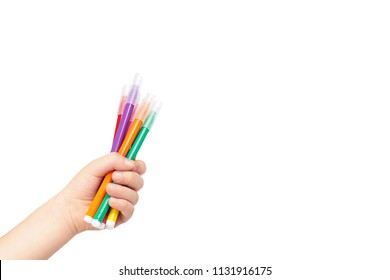 Kid hand hold color felt pen with hand, isolated on white background. copy space template.