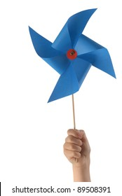 Kid hand holding a blue pinwheel close up isolated on white background.  Included clipping path, so you can easily cut it out and place over the top of a design.