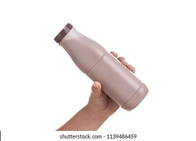 Kid Hand holding Bottle of fresh milk chocolate isolated on white background.