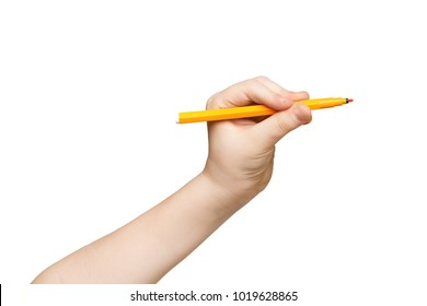 Kid hand holding felt-tip pen, writing or drawing, isolated on white background. Education, art concept