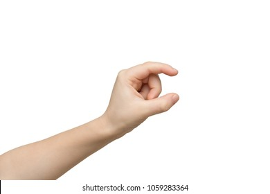 Kid hand measuring invisible items, child palm making gesture while showing small amount of something on white isolated background, side view, cutout