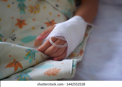Kid Patient's hand with Saline Intravenous drip.