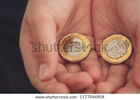kid hand showing money two pound stock photo edit now 1177044904
