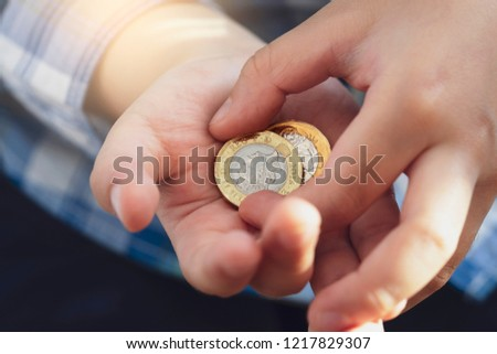kid hand showing money two pound stock photo edit now 1217829307