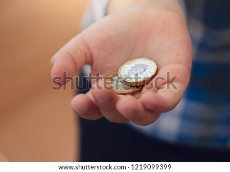 kid hand showing money two pound stock photo edit now 1219099399