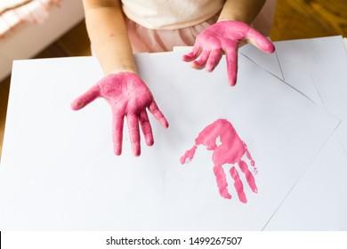 Kid hands and Handprint pink color. Flat lay, top view, overhead, mockup. Preschool Children education concept