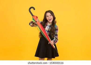 Kid happy schoolgirl with umbrella. Fall weather forecast. Feeling carefree. Schoolgirl daily life. Girl with umbrella. Happy childhood. Rainy september. Adorable small schoolgirl with backpack.