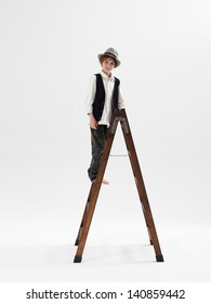 Kid with a hat on a ladder
