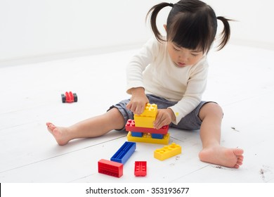 kid having fun with blocks