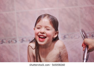 Kid having shower and enjoys water