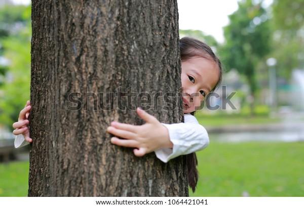 Kid Hide Body Behind Trunk Hands Stock Photo (Edit Now