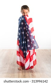 Kid holding an american flag