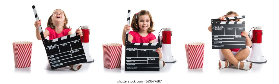 Kid holding a clapperboard
