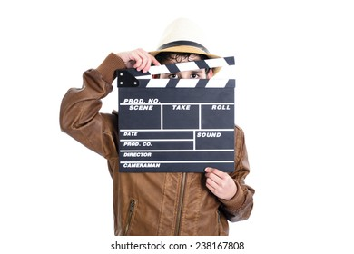 Kid holding the clapperboard covering her face leaving her eyes uncovered
