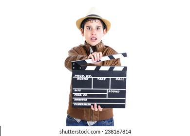 Kid holding the clapperboard with scared face