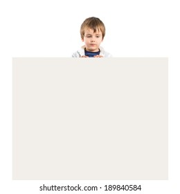 Kid holding empty placard over white background