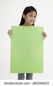 kid holding placard on the white background
