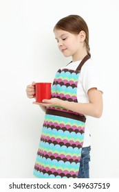 Kid holding red mug (tea cup)