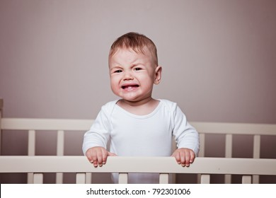 the kid holds on to the crib, takes offense, cries, is nervous.