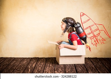 Kid with jet pack. Child playing at home. Success, leader and winner concept