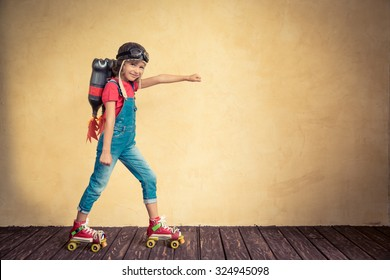 Kid with jet pack riding on roller skates. Child playing at home. Success, leader and winner concept