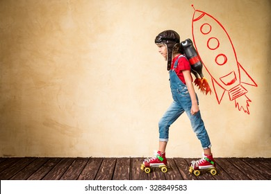 Kid with jetpack riding on roller skates. Child playing at home. Success, leader and winner concept