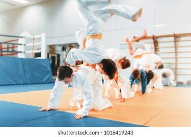 Kid judo, childrens in kimono training martial art
