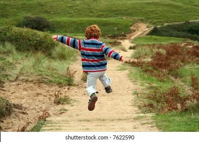 kid jumping outside