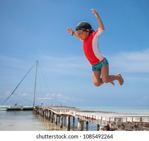 A Kid jumps in the water at Cayo Coco, Cuba