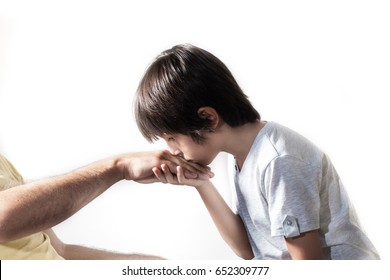 Kid kissing parent's hand for traditional act of respect