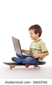 Kid with laptop on skateboard - mobile computing concept