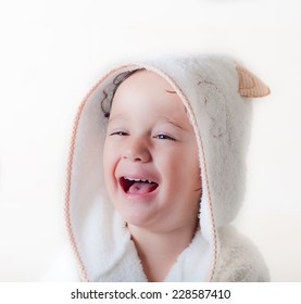 kid is laughing with a bathrobe