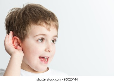 Kid listening at a distance,  isolated on white background