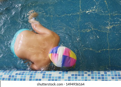 Kid / little boy at swimming lesson at school. Top view. Sports and leisure in education. Bullying problem because of weight issues. Healthy lifestyle in childhood.