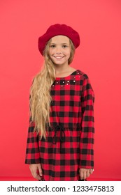 Kid little cute girl with long hair posing in hat red background. Fashionable beret accessory for female. How to wear french beret. Beret style inspiration. How to wear beret like fashion girl.
