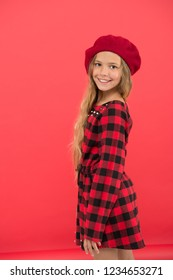 Kid little cute girl with long hair posing in hat red background. How to wear french beret. Beret style inspiration. How to wear beret like fashion girl. Fashionable beret accessory for female.